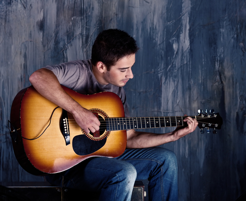 young musician playing the guitar