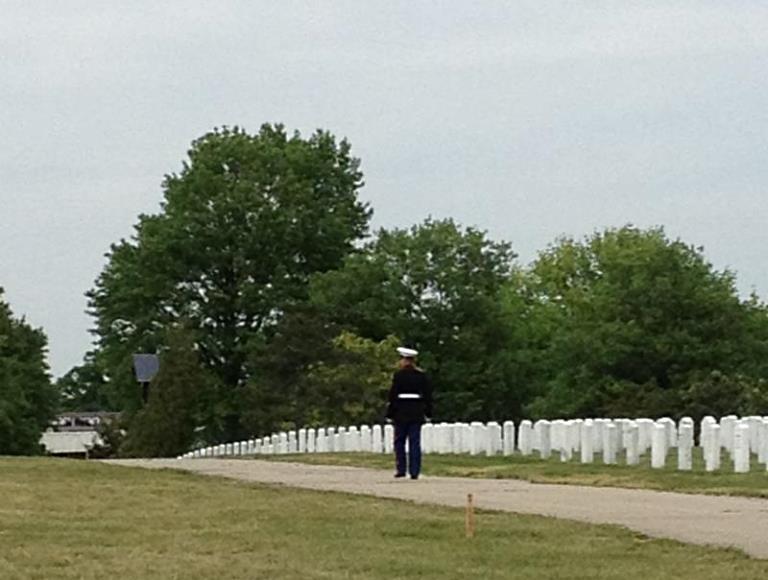 soldier walking through Arlington Cemetary