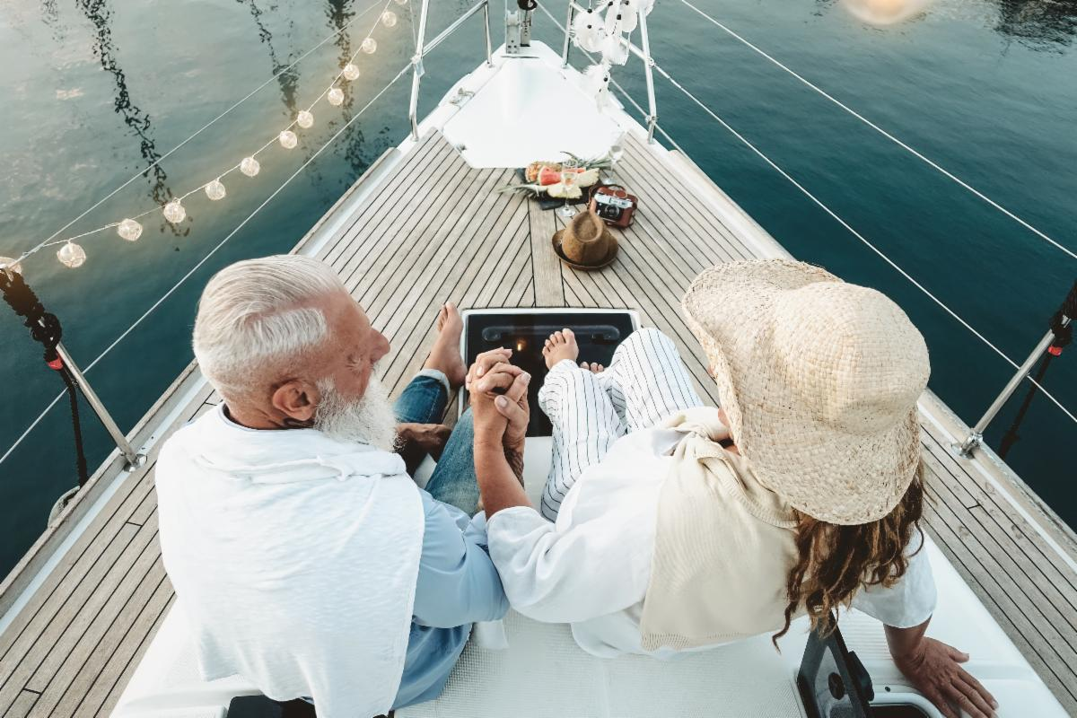 older couple holding hands on boat.jpeg
