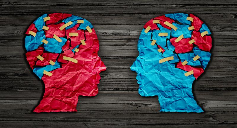 Thinking exchange and idea partnership business communication concept as a red and blue human head cut from crumpled paper sharing broken pieces as a creative collaboration symbol for understanding political opinions or cultural differences.