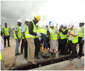 Damola Akindolire (General Manager, Alpha Mead Development Company breaking the ground)