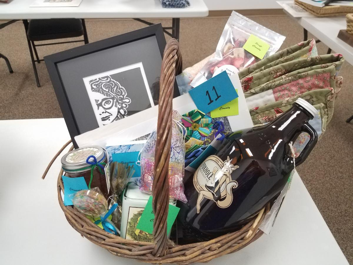 Spirit of the region raffle basket filled with art_ jars_ beer_ quilt_ and more.