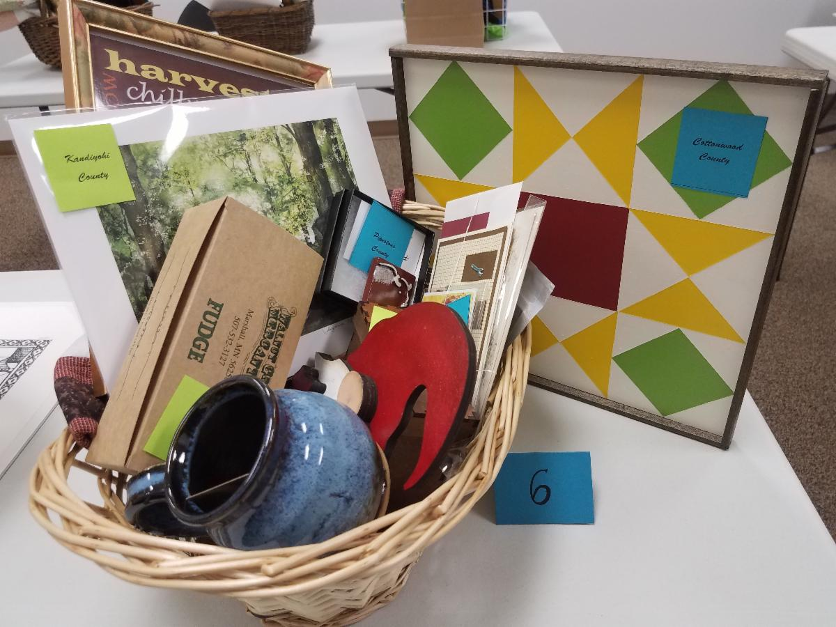 Basket with fudge_ pottery mug_ barn quilt painting and more.
