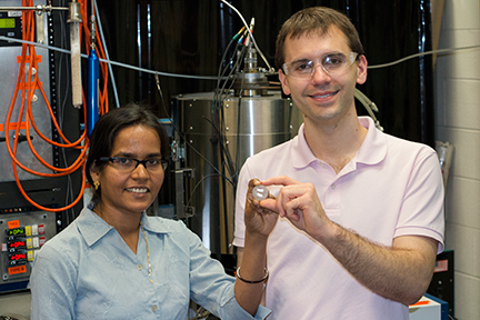 MIT postdoc Sulata K. Sahu [left] and graduate student Brian Chmielowiec hold a sample of nearly pure copper deposited on an iron electrode after extraction through chemical electrolysis.