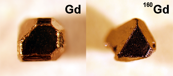_Left_ Single crystal of gadolinium_ platinum and bismuth made with naturally occurring elements. _Right_ Single crystal of GdPtBi made with isotopically enriched Gd-160 for neutron scattering experiments. Both are about 1 mm. Image_ Joe Checkelsky