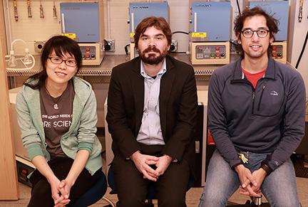 MIT Assistant Professor of Physics Joseph Checkelsky (center) and graduate students Linda Ye (left) and Aravind Devarakonda are working to uncover new properties linked to collective behavior of electrons.