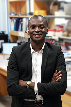 MIT Assistant Professor of Physics Ibrahim Cissé studies single molecule behavior of enzyme clusters that enable gene copying and protein production within living cells.  Photo, Denis Paiste, Materials Processing Center