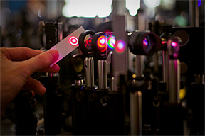 Researchers at MIT have discovered a new way of using laser light to tune electronic energy levels in two-dimensional films of crystal. The discovery could ultimately pave the way for the development of so-called ___valleytronic_ devices. Photo_ MIT News.