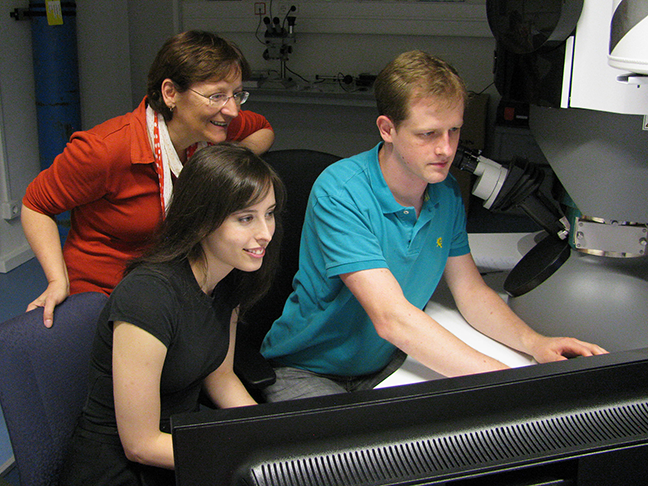 MIT graduate student Rachel V. Zucker, center, works at a new TEM with Prof. Christina Scheu, left, and Alexander Muller at the Max Planck Institute for Iron Research in Dusseldorf. Scheu hosted Zucker in collaboration with the MISTI-Germany seed fund.