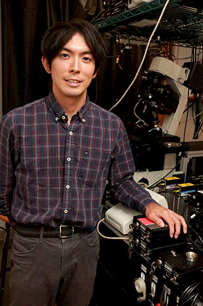 MIT Physics graduate student Takuma Inoue helped to build the super-resolution microscopy set up to study single molecule behavior of enzyme clusters that enable gene copying and protein production within living cells. Photo, Denis Paiste, MPC