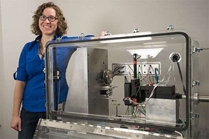 The most interesting thing about these materials is they function at temperatures above 500 degrees Celsius, says MIT graduate student Jessica Swallow, pictured with equipment used for testing new breathing materials. Courtesy of the researchers