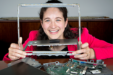 Elsa Olivetti, assistant professor of materials science and engineering at MIT, applied life cycle analysis to laptop computer manufacturing and found that one particular step, making the display can be a key driver of pollution.  Photo, Denis Paiste