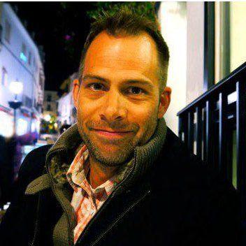 Headnshot of Eric Strom