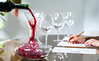 Sommelier pouring wine into decanter