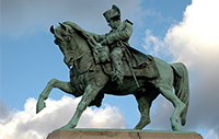 Statue of Napoleon riding a horse.