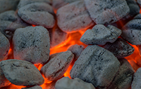 White coals covering a fire.