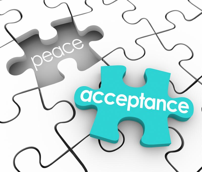 Acceptance word on a 3d blue puzzle piece and a hole with the word Peace