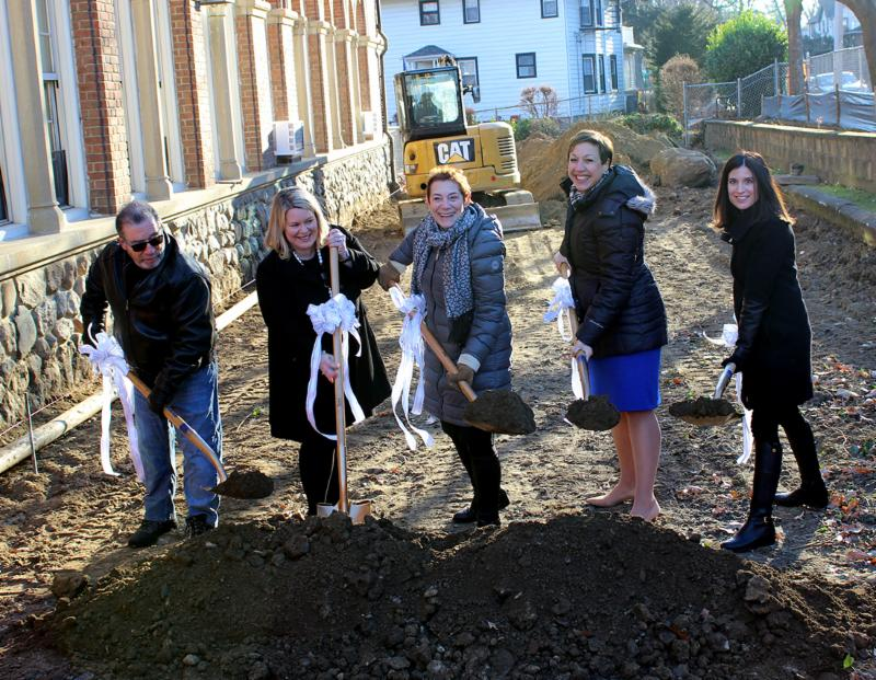 A group of five put shovels in the ground at the site of the future Siwanoy outdoor classroom