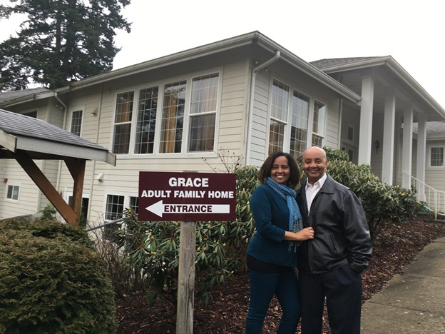 Two people standing in front of the Grace Adult Family Home