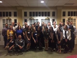 STAC Alumni meeting up at a formal dinner. A big group posing for the camera.