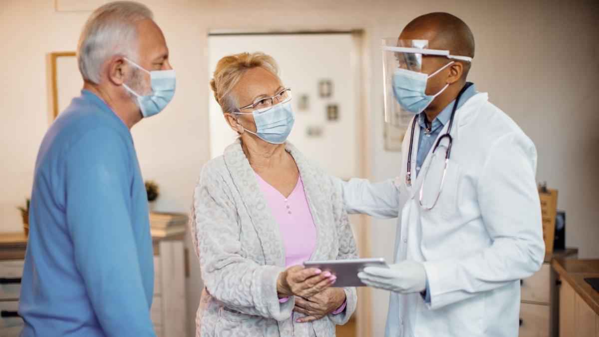 White couple with black doctor masked.jpg