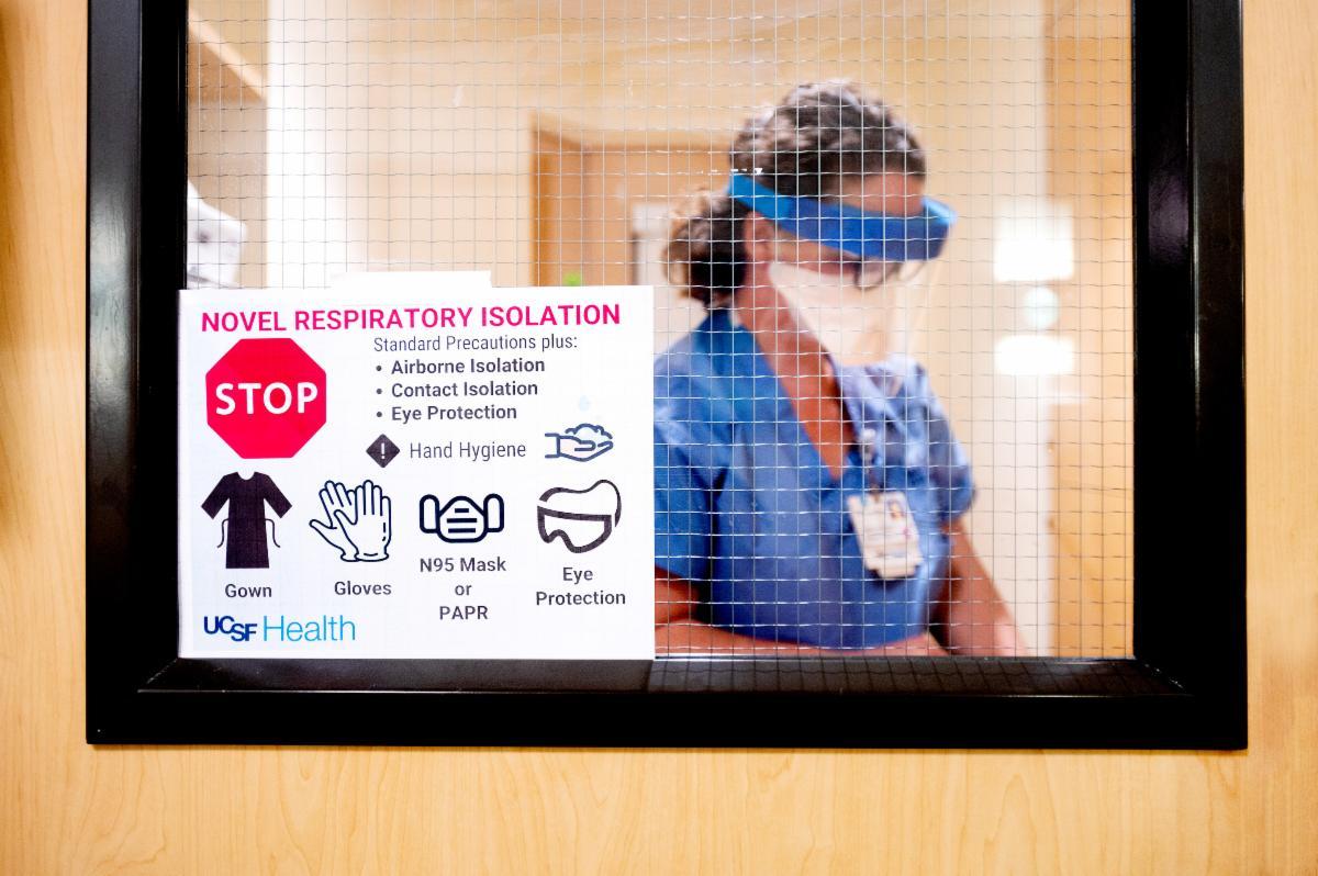 nurse-COVID19-hospital-isolation-room.jpg