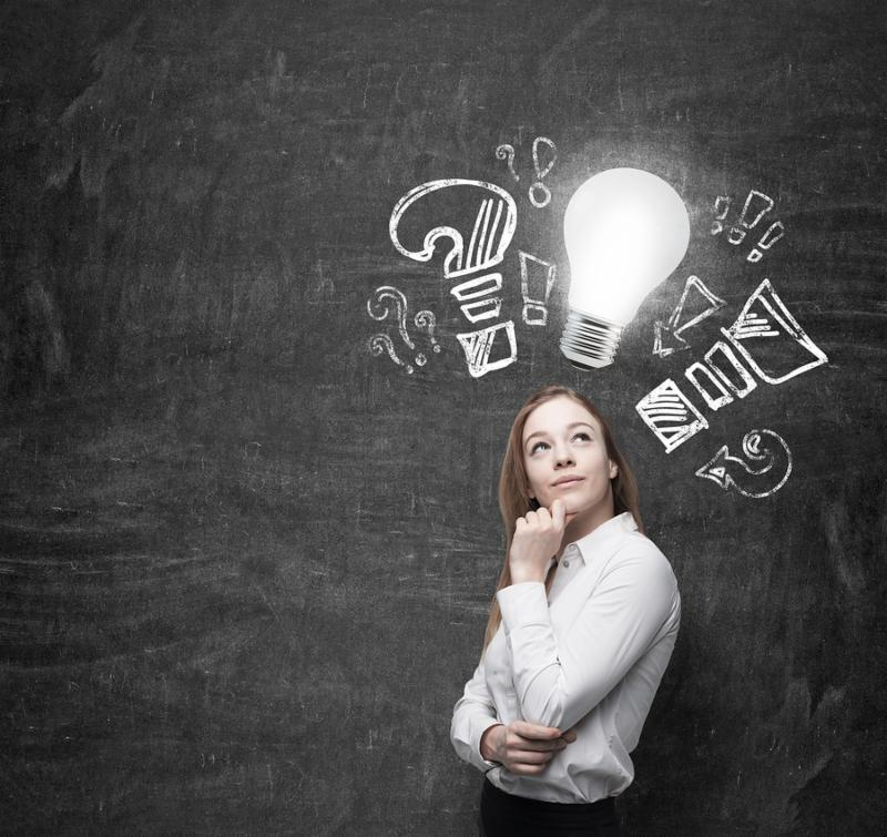 Young woman ponders about new business ideas. A light bulb as a concept of new ideas.