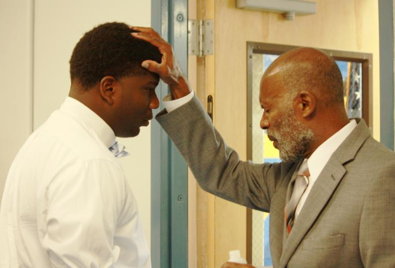 Pastor Anoints Student