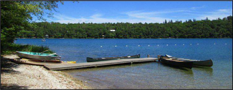 Rowboat, kayak, and canoes at the Long Pond boat dock