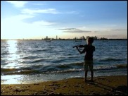 Young fiddler on Thompson Island beach