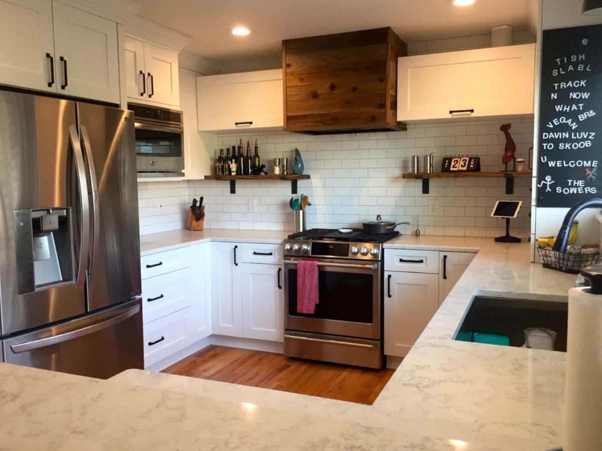 Sowers' Remodeled Kitchen White Shaker Style Cabinets with Stained Wood Range Hood Vent Cabinet