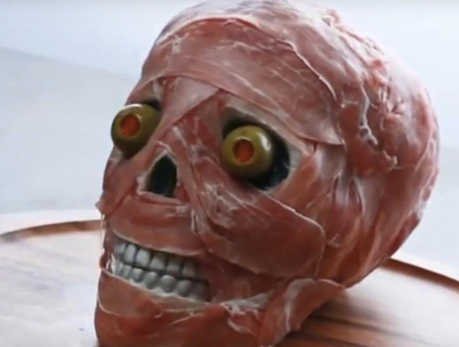 Halloween Appetizers Prosciutto Wrapped Skull will Olive Eyeballs