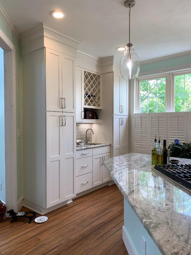 Horton Kitchen After Remodel Replaced Extra Exit to Deck with Built In White Pantry Cabinets and Wet Bar