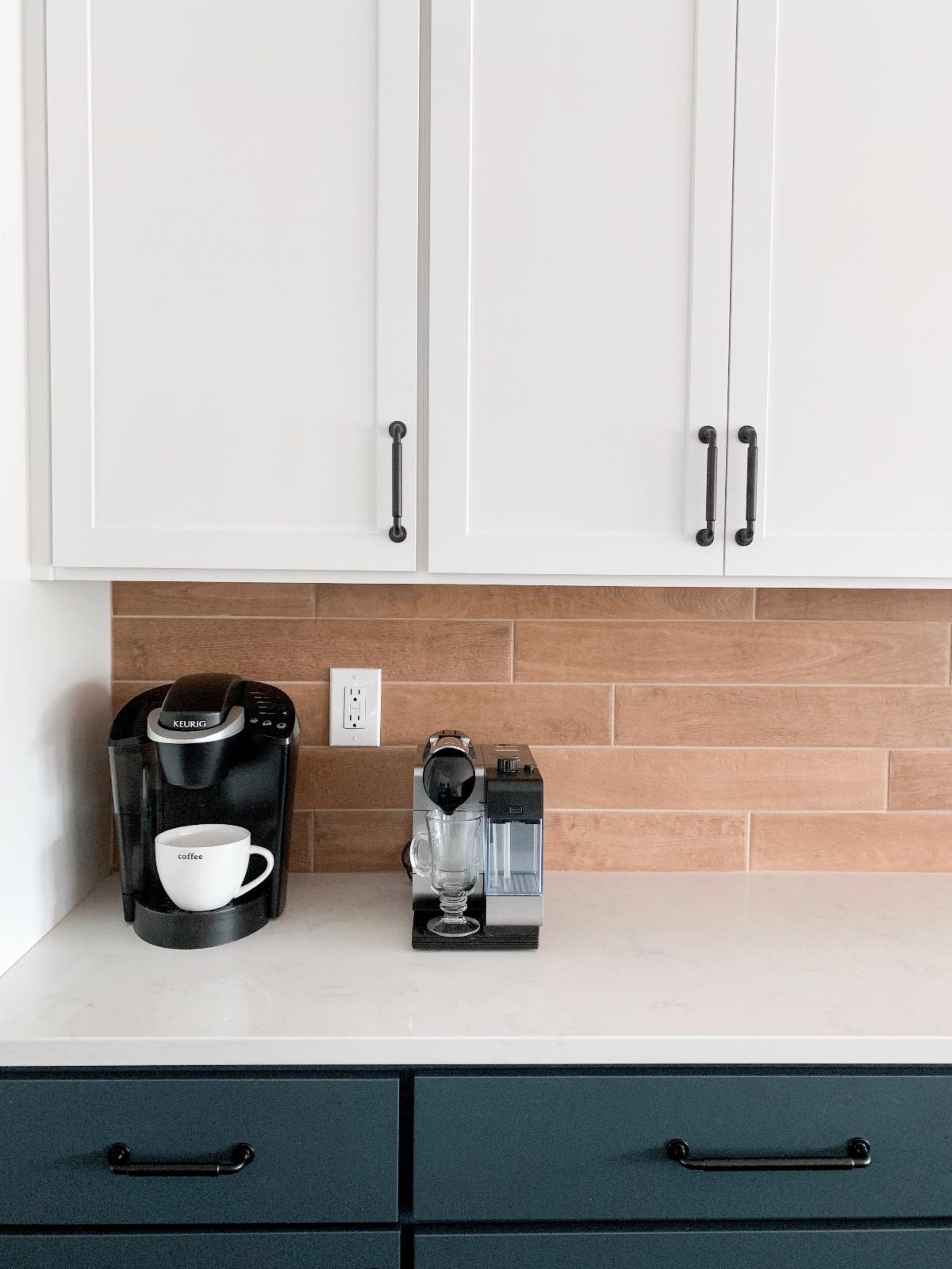 Kitchen Remodel Two-Toned Shaker Cabinets Matte Black Hardware Quartz Countertops Wood Plank Tile Backsplash