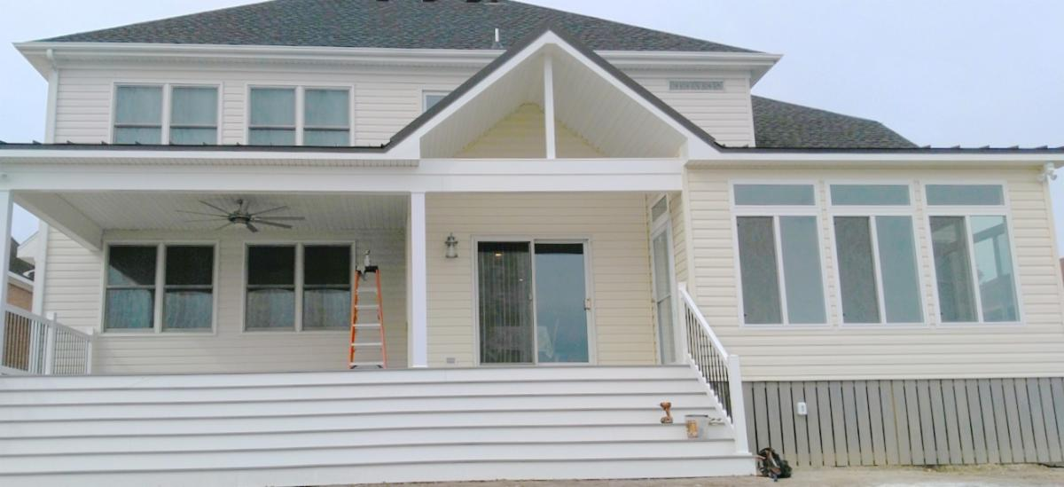 Hatchett Sunroom Addition and Covered Porch Single Seam Metal Roof