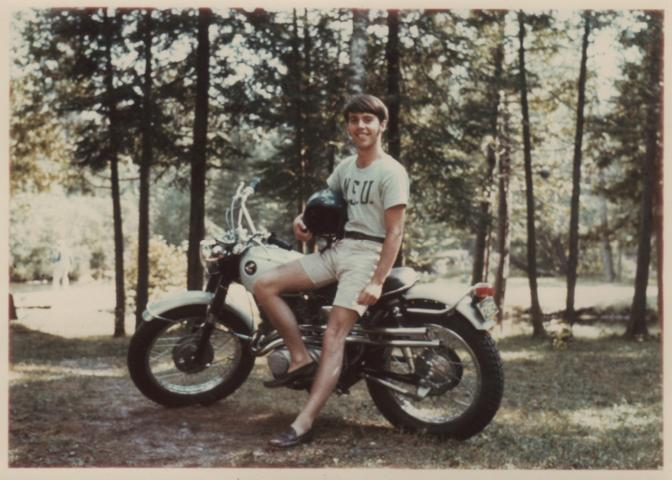 Ron Springer on a motorcycle at Higgins Lake in 1967