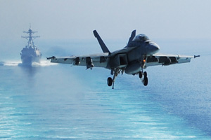 A U.S. Navy aircraft supporting operations in Iraq and Syria prepares to land in the Persian Gulf in October 2014.