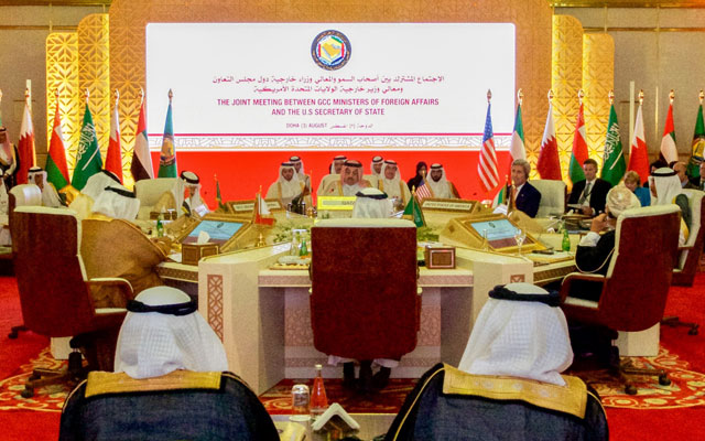 U.S. Secretary of State John Kerry listens to opening statements at a meeting about the Iranian nuclear deal with members of the Gulf Cooperation Council in Doha, Qatar, on August 3, 2015.