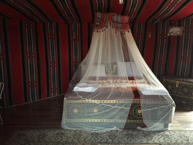 A charming bed in a bedouin tent. Bedouin means