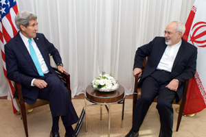 U.S. Secretary of State John Kerry sits with Iranian Foreign Minister Javad Zarif during negotiations about the future of Iran's nuclear program on January 14, 2015, in Geneva, Switzerland.