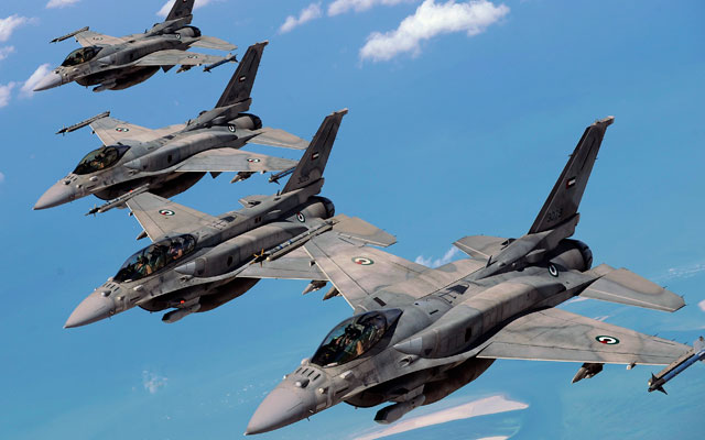 Emirati F-16 aircraft fly in formation during a multinational exercise.