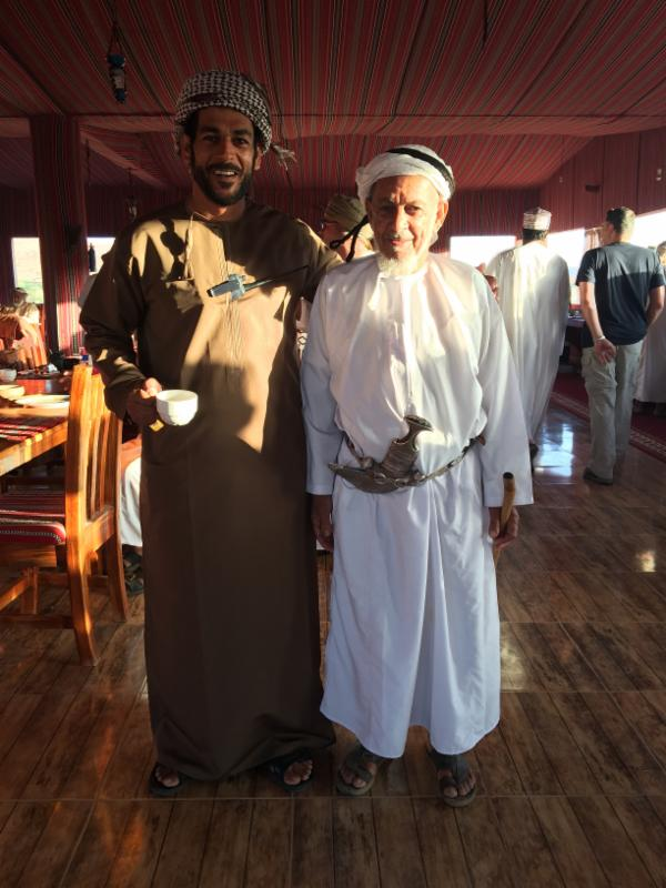 Our guide, Badar, at breakfast with an elderly gentleman who had traveled to the camp for the event.