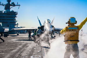 An F/A-18 Hornet on the flight deck of an aircraft carrier in the Gulf on January 1, 2015, conducting air operations in Iraq and Syria.