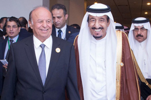 Saudi Arabia's King Salman bin Abdulaziz Al Saud departs the March 2015 Arab League summit in Sharm El-Sheikh with Yemen's President Abed Rabbo Mansour Hadi.