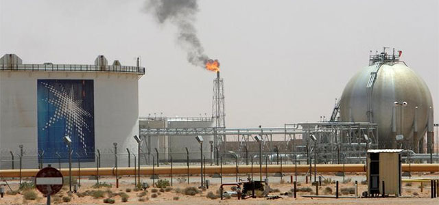 A gas flame is seen in the desert near the Khurais oilfield in Saudi Arabia.