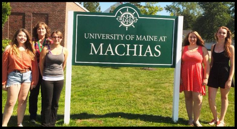 Lori McBrine pictured with UMaine Machias students