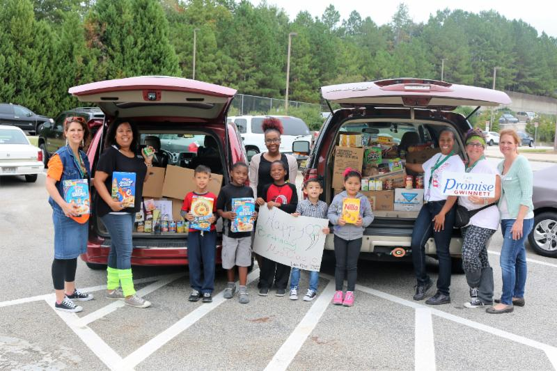 Rock Springs students and teachers stand with canned food donations to co-op