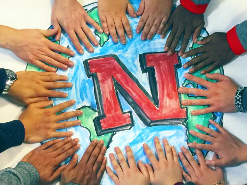 Hands of participants at UNL Global Leadership Retreat 2016