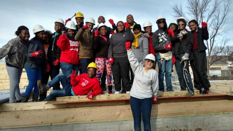 SUSI students visiting UNL participate in a Habitat for Humanity project.